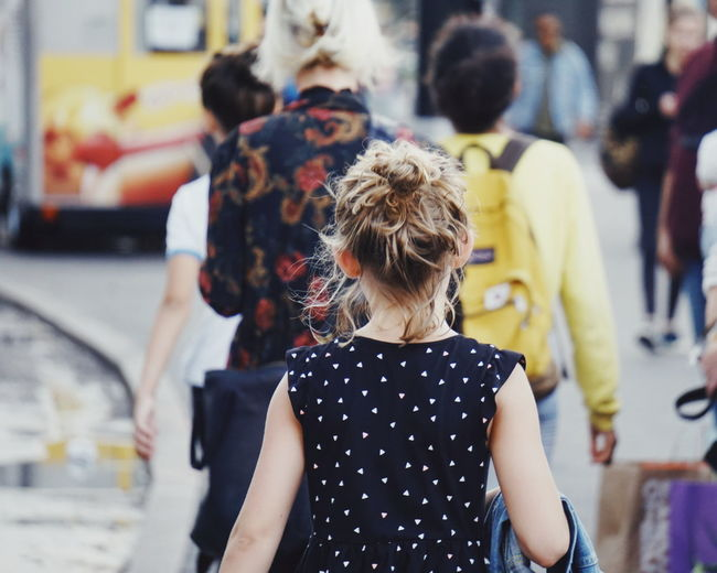 Pretty little lady at Manhattan Dress Manhattan NY NYC NYC Photography New York New York City Childhood Curly Hair Day Focus On Foreground Girl Incidental People Leisure Activity Lifestyles Men Outdoors People Pretty Pretty Girl Real People Rear View Standing Street Transportation Walking Women An Eye For Travel