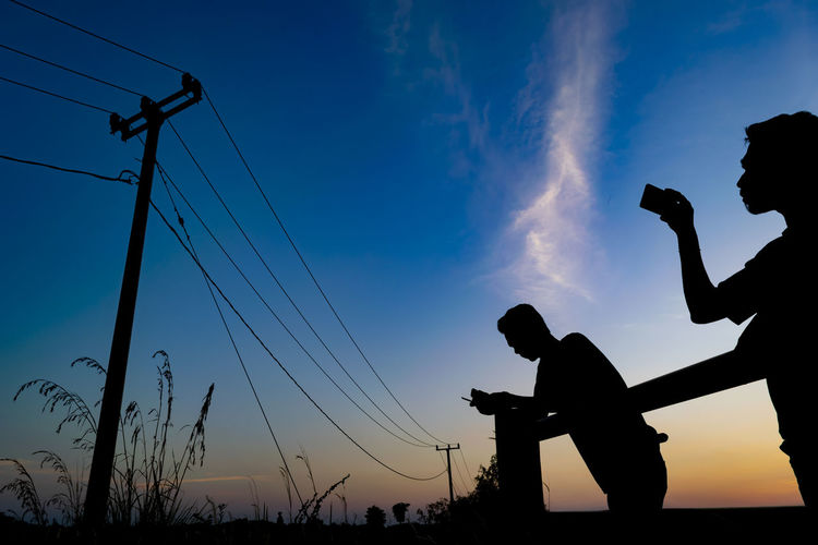 Backgrounds Colors Colorful Outdoors Dark Sunset Copy Space Lifestyles Taking Pictures Taking Photos Freshness Blue Sky Blue Hour Silhouette Men Sky Electricity Pylon Electricity Tower Electricity  Outline