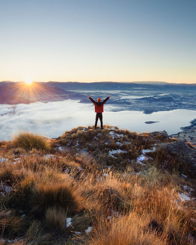 Wanaka Arms Raised Beauty In Nature Freedom Full Length Human Arm Land Leisure Activity Lens Flare Lifestyles Limb Men Mountain Nature Non-urban Scene One Person Real People Rear View Royspeak Scenics - Nature Sky Standing Sun Sunset Tranquil Scene Tranquility