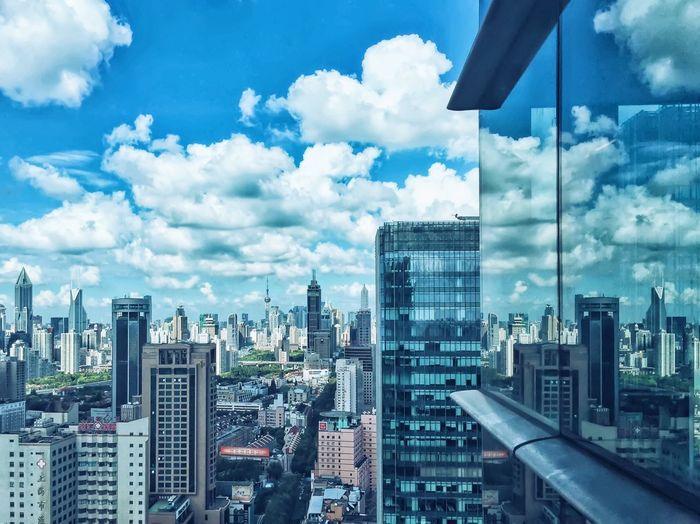 Cityscape reflection on huaihai international plaza window glass