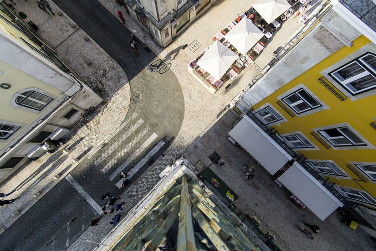 High angle view of street amidst buildings in city