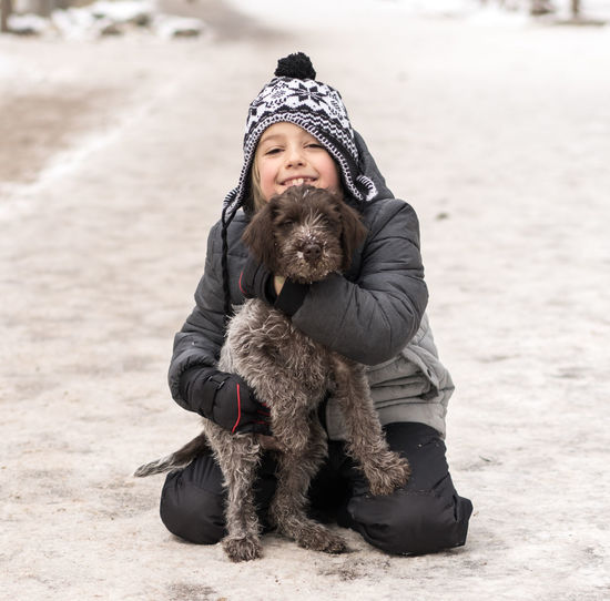 Happy Hiking Love Winter Animal Themes Boy Child Day Dog Domestic Animals Friendship Full Length Griffon Leisure Activity Mammal Nature Outdoors Outdoors, Outside, Open-air, Air, Fresh, Fresh Air, People Pets Puppy Smiling Snow Trail Warm Clothing Moments Of Happiness