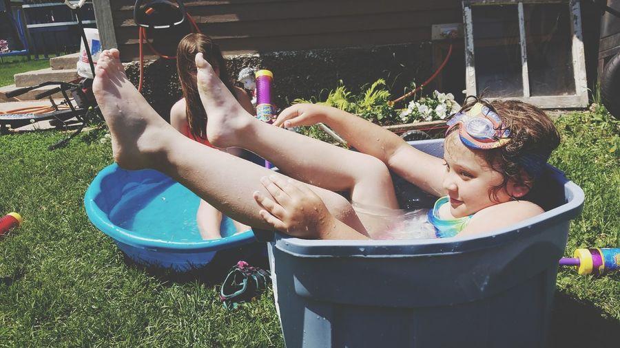 Sisters In Wading Pools At Yard