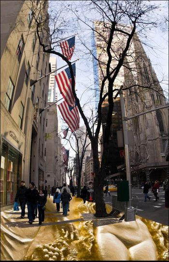 The Streets are Paved w/ Gold - 12/2012 3 American Flags 5th Ave. 47th To 50th St. Architecture Building Exterior Composite From Building Exterior To Pavement People Shopping Rockefeller Ctr. St. Patricks Cathedral Winter Foliage