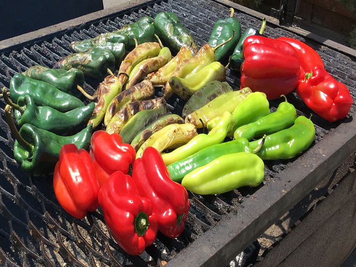 A variety of red and green peppers on a grill Pepper Vegetable Food And Drink Bell Pepper Freshness Food Red Red Bell Pepper Green Color No People High Angle View Close-up Still Life Wellbeing Spice Chili Pepper Green Bell Pepper Choice Preparation  Paprika