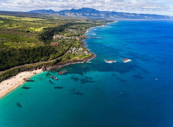 Aerial view of Waimea bay and the north shore of Oahu Hawaii Coastline Hawaii Oahu Pacific USA Above Aerial View Beach Beauty In Nature Blue Day High Angle View Landscape Nature Nautical Vessel North Shore Ocean Outdoors Scenics Sea Seascape Sky Tranquility Waimea Bay Water