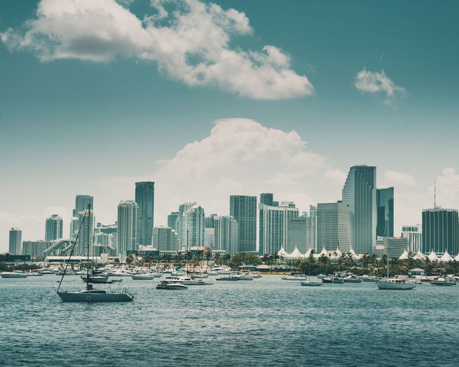 Miami Architecture City Building Exterior Sky Nautical Vessel Built Structure Water Transportation Building Mode Of Transportation Cloud - Sky Waterfront Urban Skyline Cityscape Landscape Skyscraper Office Building Exterior Nature Sea No People Outdoors Modern Yacht Sailboat Financial District