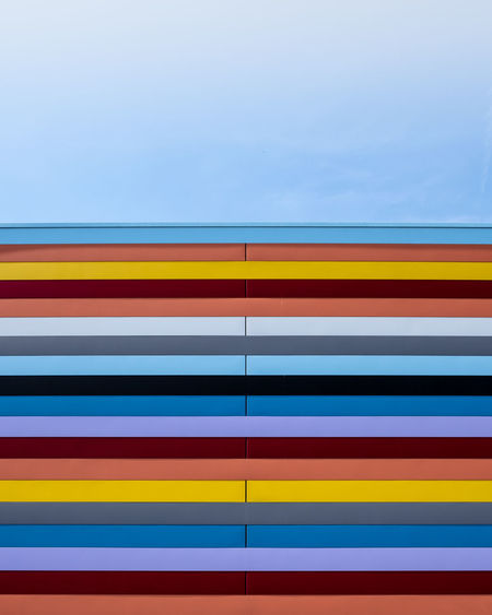 Colorfacade Multi Colored Built Structure Architecture Pattern No People Day Fujix_berlin Ralfpollack_fotografie Minimalism Minimalist Photography  Striped Full Frame Blue Yellow Backgrounds Wall - Building Feature Close-up Copy Space Low Angle View Building Exterior Outdoors Sky