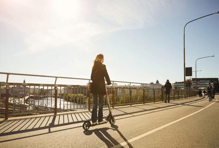 Rear view of woman walking on bridge