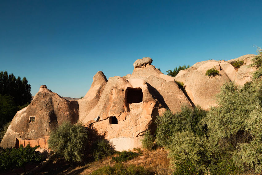 Gulsehir - Rose City Anatolia, Architecture, Asia, Beauty, Bizarre, Cappadocia, Cave, Chimney, Chimneys, Church, Cone, Country, Culture, Earth, Eroded, Erosion, Fairy, Famous, Formation, Geological, Geology, Goreme, House, Kapadokya, Landscape, Limestone, Love, Mount, Mountai Archeological Boulder, Stone, Pebble, Rock Cappadocia/Turkey Caves Clear Sky Gulsehir, Rose City, Cappadocia, Turkey, Anatolia Historical Sights Rock Formation Tourism Tourist Attraction  Tourist Destination Zoropassos