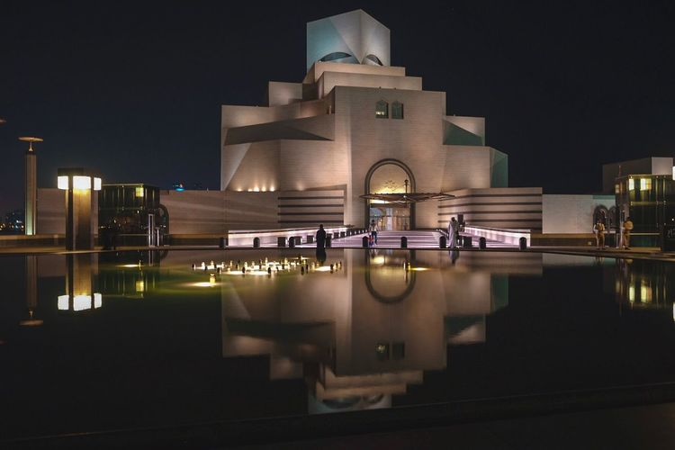 Museum of Islamic Art Qatar Museum Of Art Museum Building Exterior Night Built Structure Architecture Reflection Illuminated Water City Building Sky No People Nature Outdoors Waterfront Travel Destinations Modern Transportation Travel Residential District Reflecting Pool