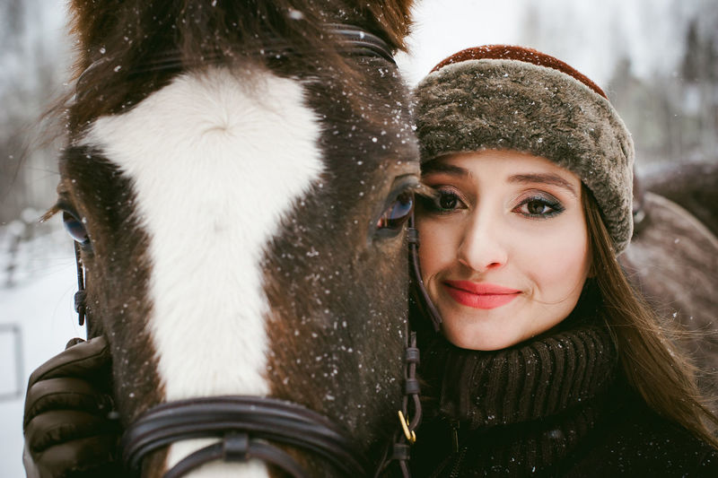 Beautiful Woman Close-up Cold Temperature Day Front View Fur Fur Coat Fur Hat Happiness Headshot Knit Hat Leisure Activity Lifestyles Looking At Camera Mammal One Person Outdoors Portrait Real People Smiling Snow Warm Clothing Winter Young Adult Young Women