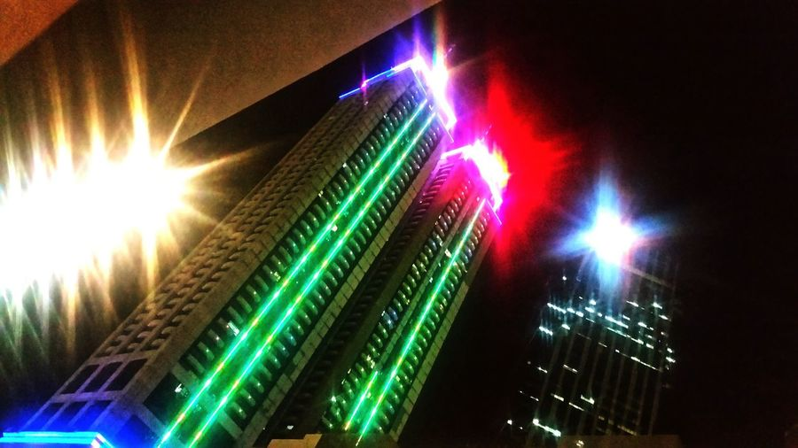 Twin Towers Illuminated Arts Culture And Entertainment Nightlife Night Light Beam Multi Colored Technology EyeEmNewHere