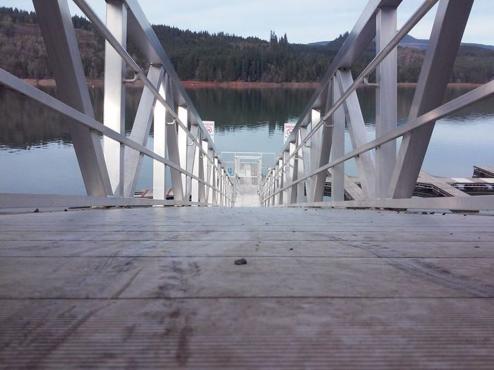 Surface level view of pier in lake