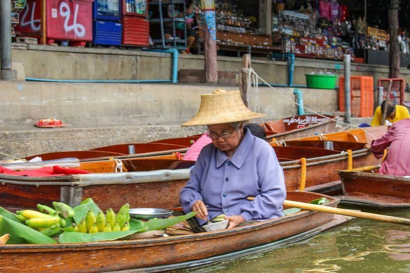 Asian woman in boat