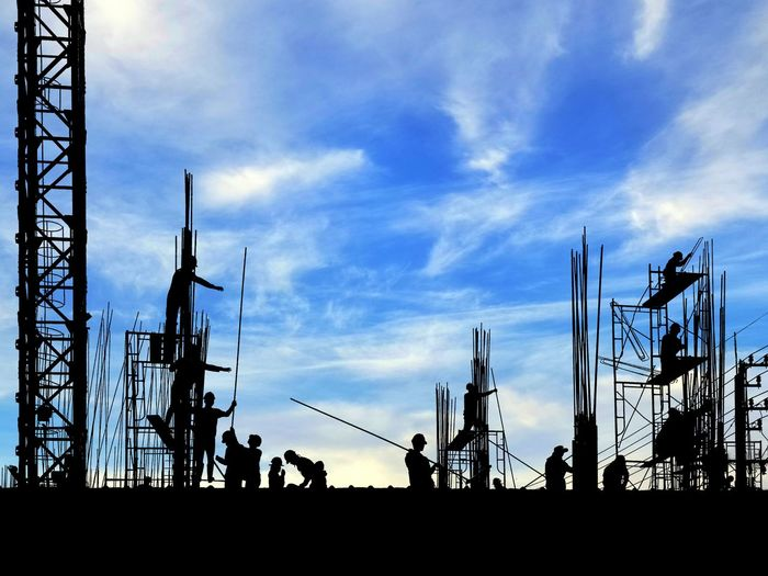 Silhouette construction workers group are working to build reinforcement structure on top of building with crane and blurred clouds with blue sky background Team Group Bright Occupation Working Building Top Of Technology Development Reinforcement Structure City Silhouette Sky Architecture Built Structure Cloud - Sky Building Exterior Construction Scaffolding Crane Site Worker Daytime Urban Scenery Crane - Construction Machinery Construction Site Incomplete
