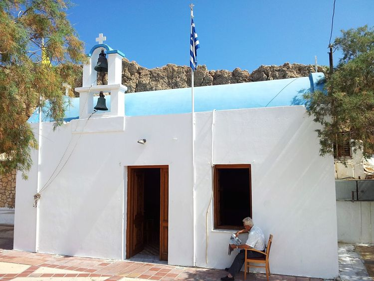 Crete Greece Chapelle Men Newpaper Journal Blue Sky Sunlight Chapel Clear Sky Religion Outdoors Day One Person