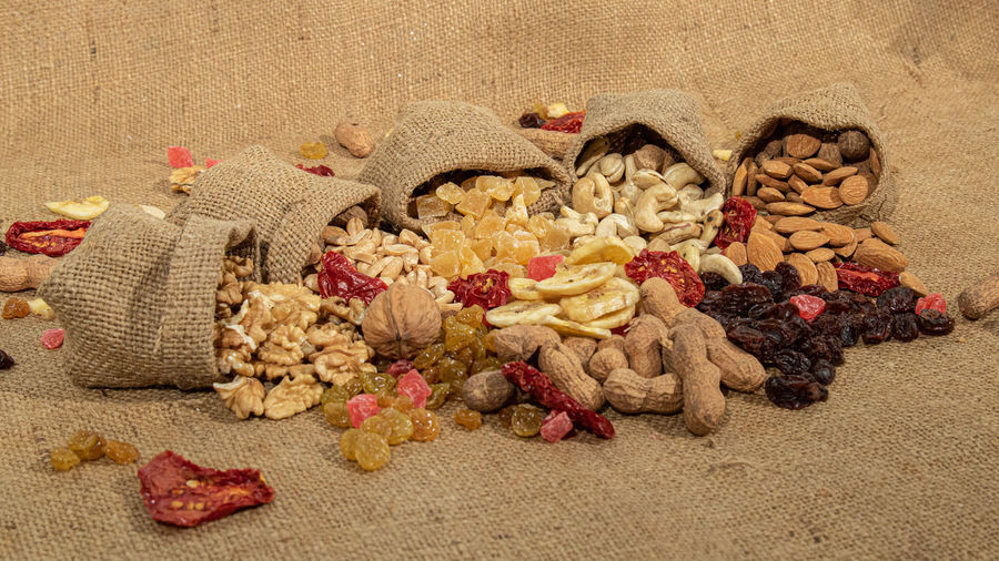 Close-up of dried fruits on sand
