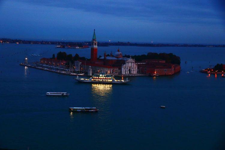 View of illuminated city at waterfront