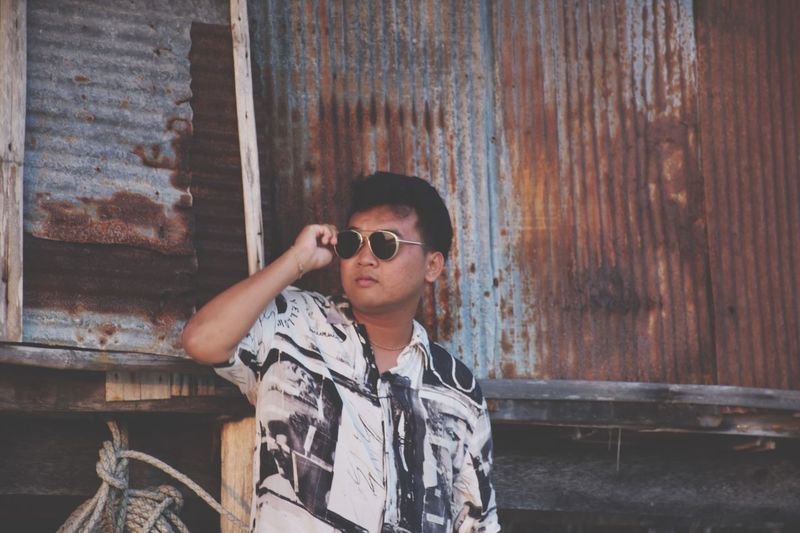 A man. Sunglasses Fashion Young Adult One Person Young Men Casual Clothing Outdoors Lifestyles Leisure Activity Cool Real People Day Portrait Standing Building Exterior Corrugated Iron People Adults Only Summer Beautiful Copy Space Garden EyeEm Best Shots EyeEm Gallery Colorful