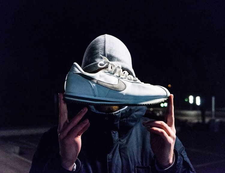 NIKES. Human Body Part Human Hand One Person Holding Night Technology People Adults Only City One Man Only Close-up Only Men Outdoors Adult Headwear Face Guard - Sport Young Adult Shoe Sneakers Sneaker Nike Kicks