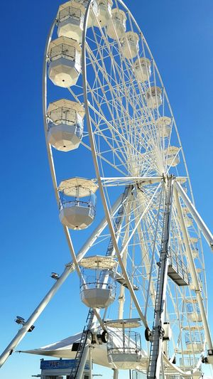 Ferris Wheel Low Angle View Clear Sky Blue Sky Outdoors Big Wheel Tourism Eyeem Market Eye4photography  Check This Out Eyeem Collection