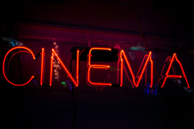 Cinema City Close-up Communication Copy Space Film Film Industry Illuminated Movies Neon Neon Light Night Nightclub Nightlife No People Outdoors Red Sign Single Word Text Vibrant Colour
