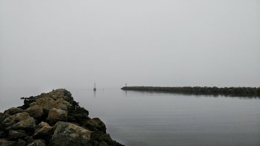Tranquility Sea Nature No People Outdoors Beauty In Nature Sky Day Water City UnderSea California Foggy Morning Marine Navigation Rock Pile Boat