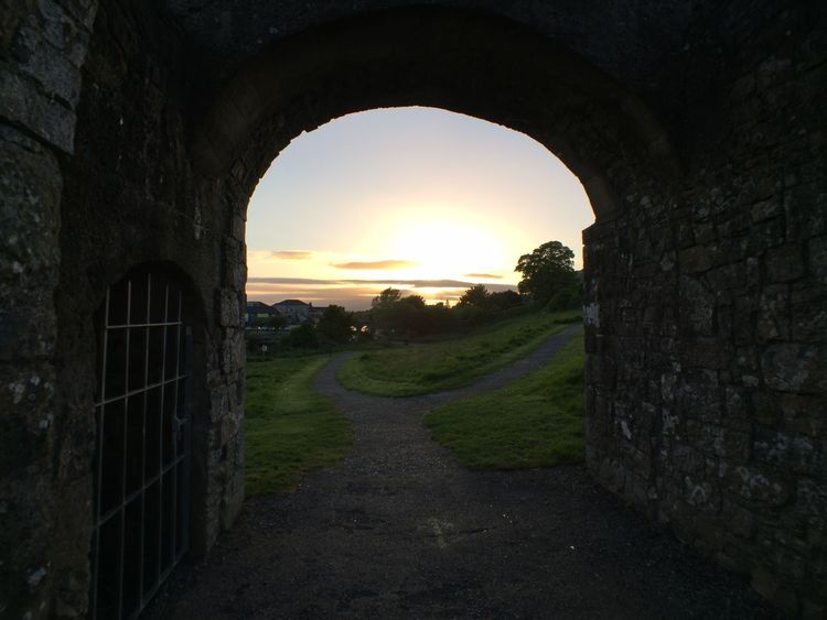 Ancient History Arch Architecture Beauty In Nature City Day Fort Grass Historical Building History Ireland Irish Landscape Medieval Nature No People Outdoors Sky Sunset Travel Travel Destinations Tree Vacations