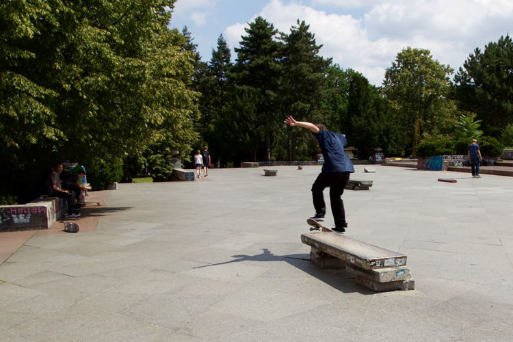 Casual Clothing Concrete Concrete Jungle Day Full Length Grind Ledge Leisure Activity Lifestyles Marble Marbledstone Ollie Outdoors Prague Praha Skate Skateboard Skateboarder Skateboarding Skating Soviet Architecture Street Photography Street Skating Tree Water