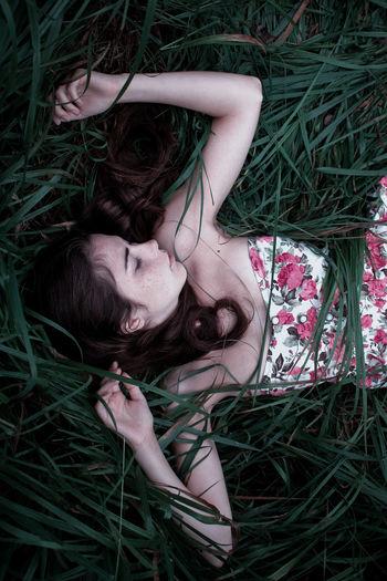 Woman sleeping on field