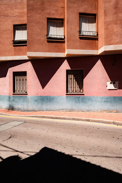 Minimalist Architecture Pastel Power SPAIN The Week on EyeEm Totana Apartment Architecture Building Building Exterior Built Structure City Day Empty Full Frame House Minimal Minimalism No People Outdoors Residential District Road Shadow Street Sunlight Window