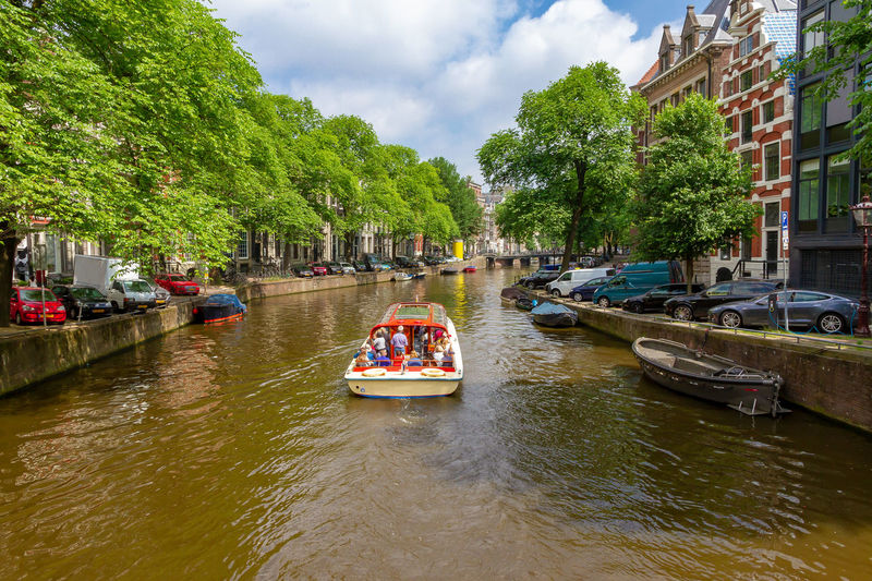 Idyllic Amsterdam Amsterdam Netherlands Canal Gracht City Travel Tourism Water Green Destination Vacations Spring Summer Bridge Architecture Nature Nature Traveling Sightseeing Dutch Trees Holland Romantic Sky Leisure Activity Activity