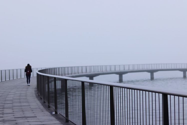 Sometimes, walking alone is the best and yet the hardest thing that you have to do.... Water Full Length Footbridge Cold Temperature Sea Winter Fog Bridge - Man Made Structure Walking Railing Foggy Tranquil Scene Calm Idyllic