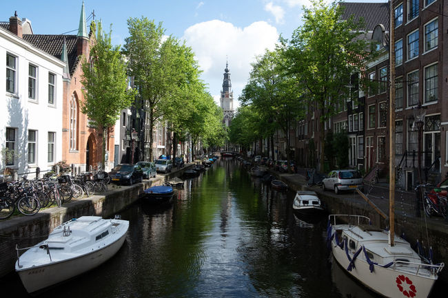 Amsterdam Amsterdam Canal Architecture Boats Building Building Exterior Built Structure Canal Canals And Waterways City Day Incidental People Mode Of Transportation Moored Nature Nautical Vessel Outdoors Plant Residential District Sky Transportation Tree Water Waterfront Yacht