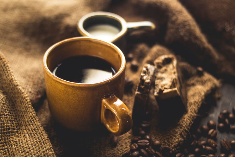 Black coffee Arabica In brown glass And milk and dessert Sack background in low light area Close-up Day Freshness Indoors  No People Selective Focus Still Life