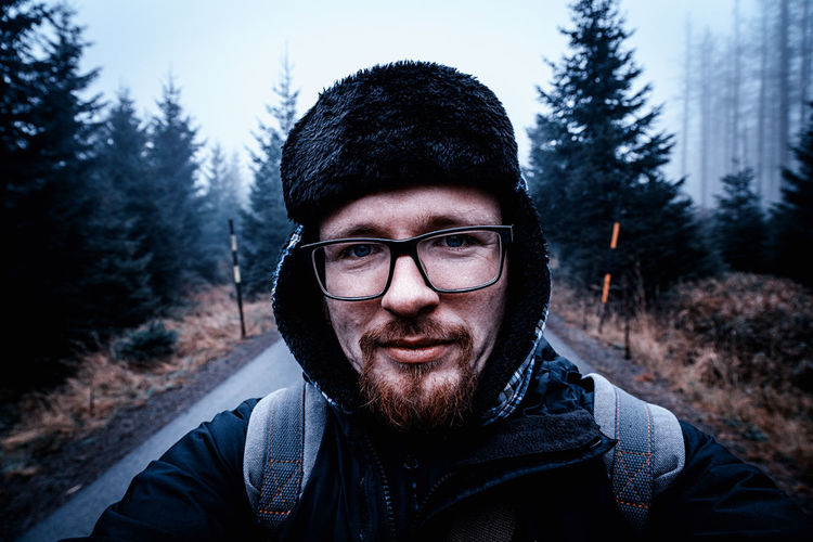 Portrait Of Man Wearing Warm Clothing On Road During Winter