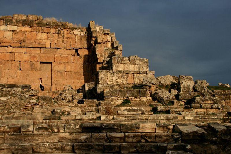 Young woman at historic old ruins