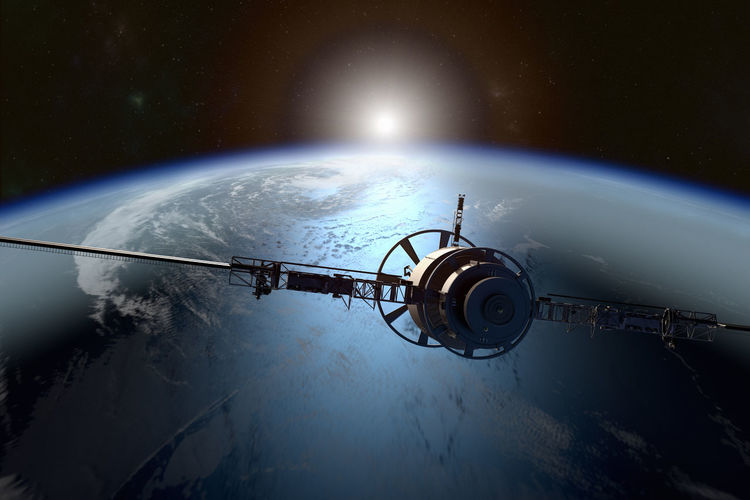 Aerial view of satellite over earth planet