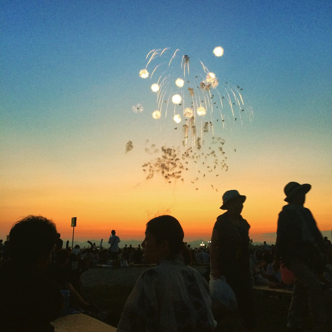 celebration, large group of people, silhouette, sky, real people, togetherness, sunset, flying, event, men, lifestyles, outdoors, women, clear sky, night, nature, people