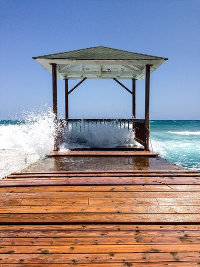 Water Sea Sky Motion Horizon Over Water Horizon Clear Sky Nature Wave Day No People Splashing Beauty In Nature Scenics - Nature Wood - Material Land Architecture Beach Pier Outdoors Power In Nature Breaking