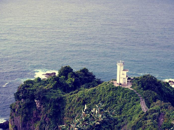 Elevated View Of Lighthouse On Cliff
