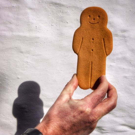 Gingerbread man Human Body Part Human Hand Close-up One Person People Day Gingerbread Gingerbreadman Gingerbread Men Holding Holding Up Hand Shadow Wall Man
