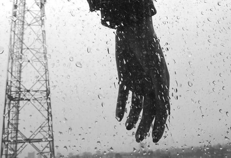 Close-up of wet car against sky