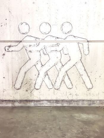 Pedestrians crossing warning sign wth three figures on wall faded No People Indoors  Day Close-up EyeEmNewHere Invisible People Three Figures Wall Sign No Crossing Disappearing Missing Pedestrian Walkway Pedestrian Traffic Safety Abstract Conceptual Outlines Traffic Parking Garage Invisible Man Break The Mold