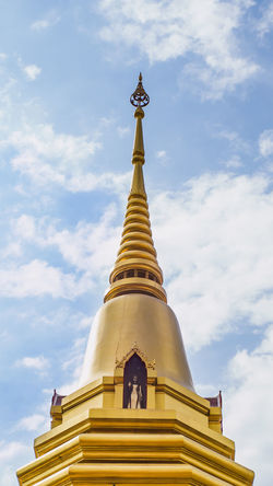 Close up of the top of the old golden pagoda in thai temple, with beautiful blue sky and cloud. Buddha Cloud Copy Space Famous Pagoda Architecture Buddha Statue Buddhism Buddhist Temple Building Exterior Built Structure Cloud - Sky Gold Colored Low Angle View No People Outdoors Peaceful Place Of Worship Religion Religious  Sky Spirituality Statue Temple Traditional