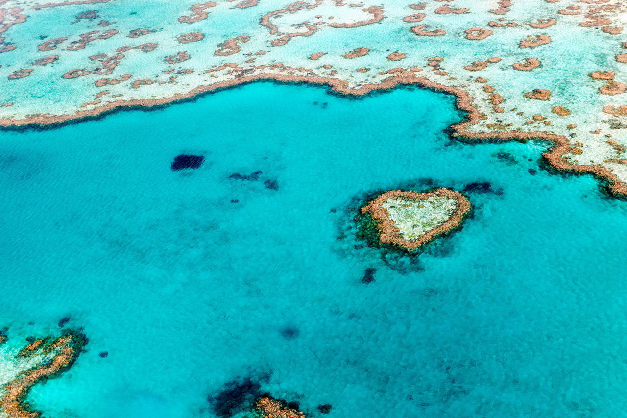 Aerial view of heart shape island in sea