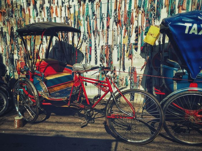 Transportation No People Day Mode Of Transportation Land Vehicle City Bicycle Street Motor Vehicle Sunlight Nature Multi Colored Architecture Graffiti Stationary Outdoors Built Structure Seat Creativity Shadow