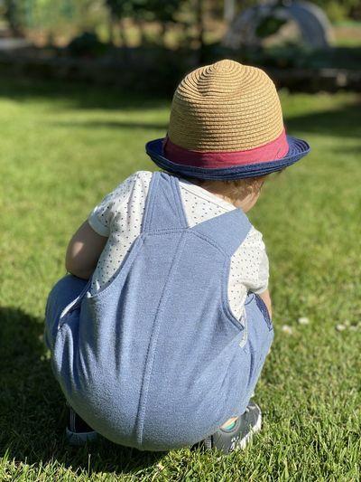 Rear view of man wearing hat on field
