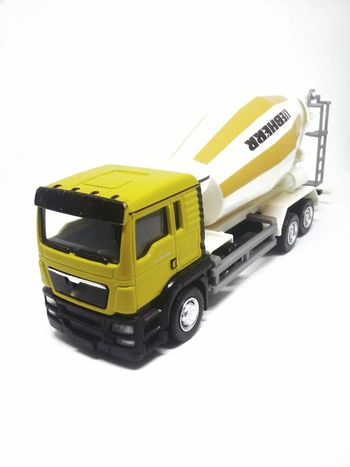 Freight Transportation White Background Transportation Cut Out Toy Mode Of Transport Land Vehicle Business Finance And Industry Yellow Industry Toy Car No People Cemen Turck Lorry Tracks Contractions Close-up Transportation Golden Light Topgear